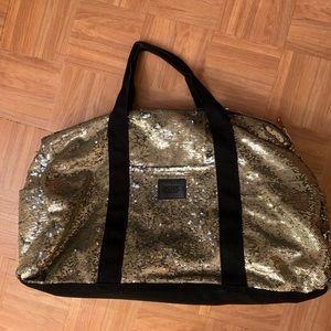 Gold sequin duffel bag